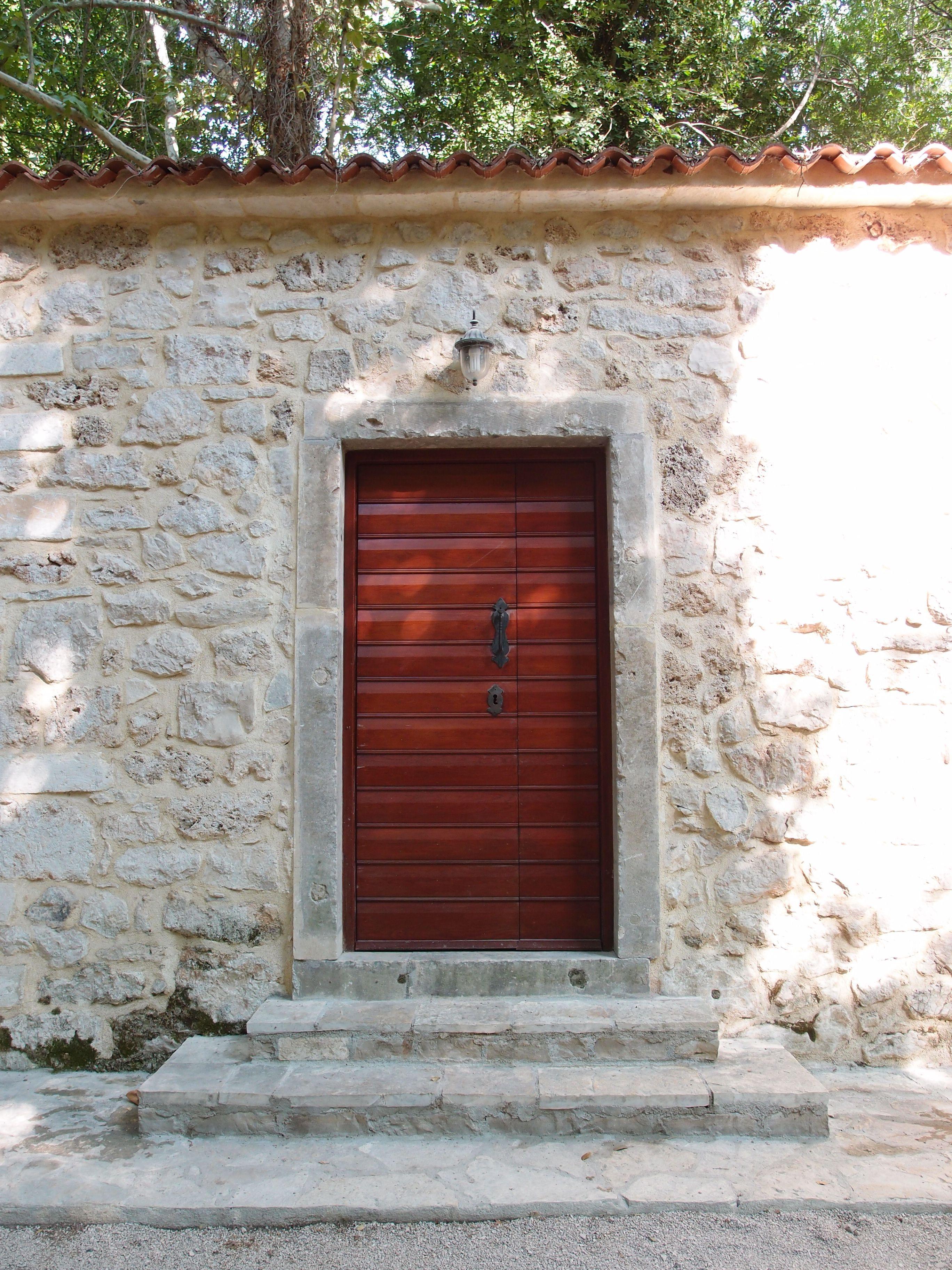 Red Wooden Door In Eastern Europe Photographed By Marleen Van