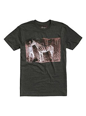 """<div>Is this image fact or fiction? The world may never know. Leave it to Gus Fink to cause a commotion. Heather grey tee from artist Gus Fink's Antique Horror collection titled """"Death Unicorn.""""</div><div><ul><li style=""""LIST-STYLE-POSITION: outside !important; LIST-STYLE-TYPE: disc !important"""">60% cotton; 40% polyester</li><li style=""""LIST-STYLE-POSITION: outside !important; LIST-STYLE-TYPE: disc !important"""">Wash cold; dry low</li><li style=""""LIST-STYLE-POSITION: outside !important; LIST-..."""