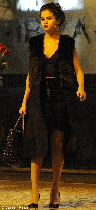 All the best! Selena Gomez opted to wear a leather skirt and a fur vest to dine in the fashionable city