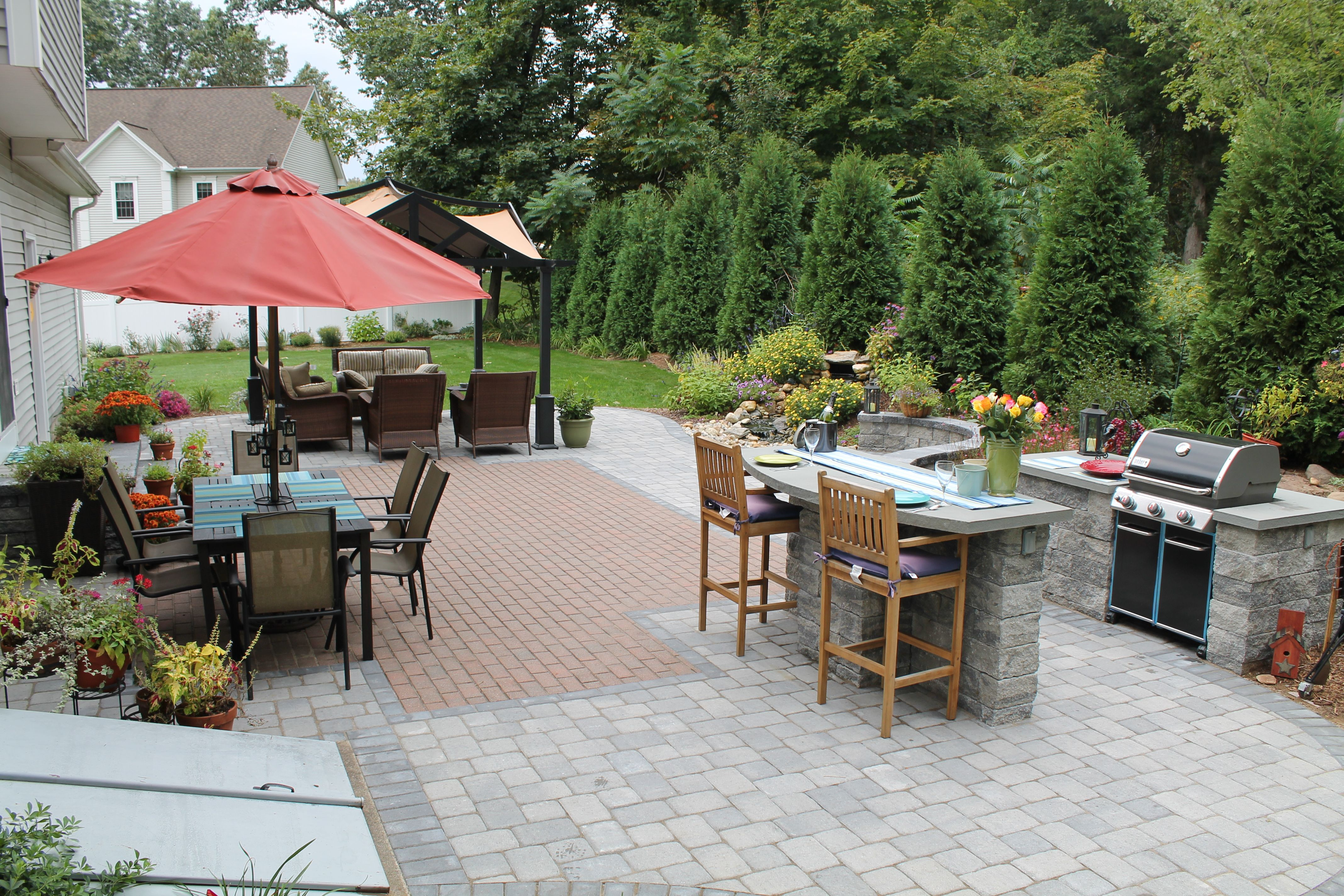 Outdoor Kitchen With Built In Grill And Bar On Paver