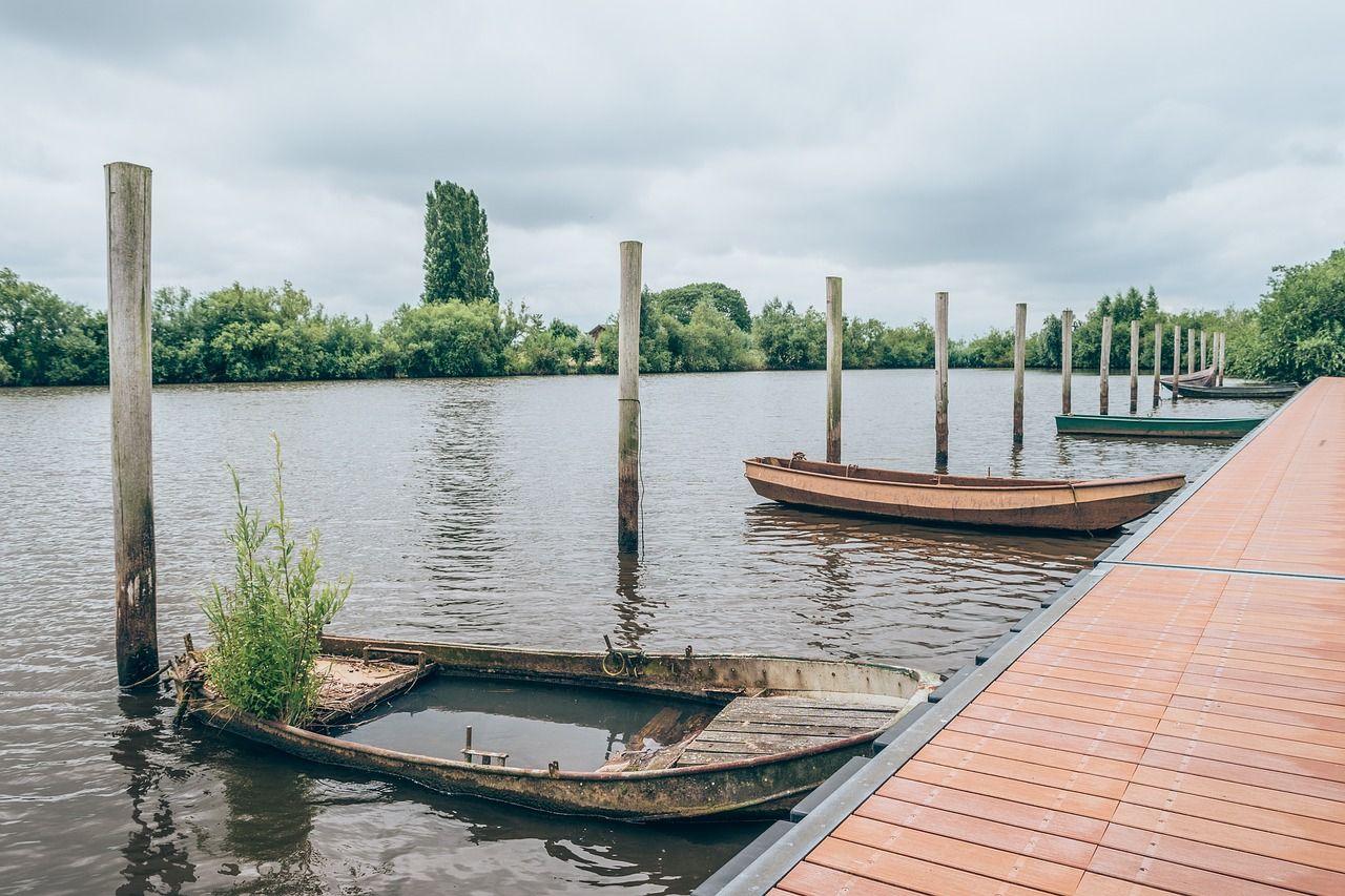 Boat wooden post bay boat lake water boat wooden