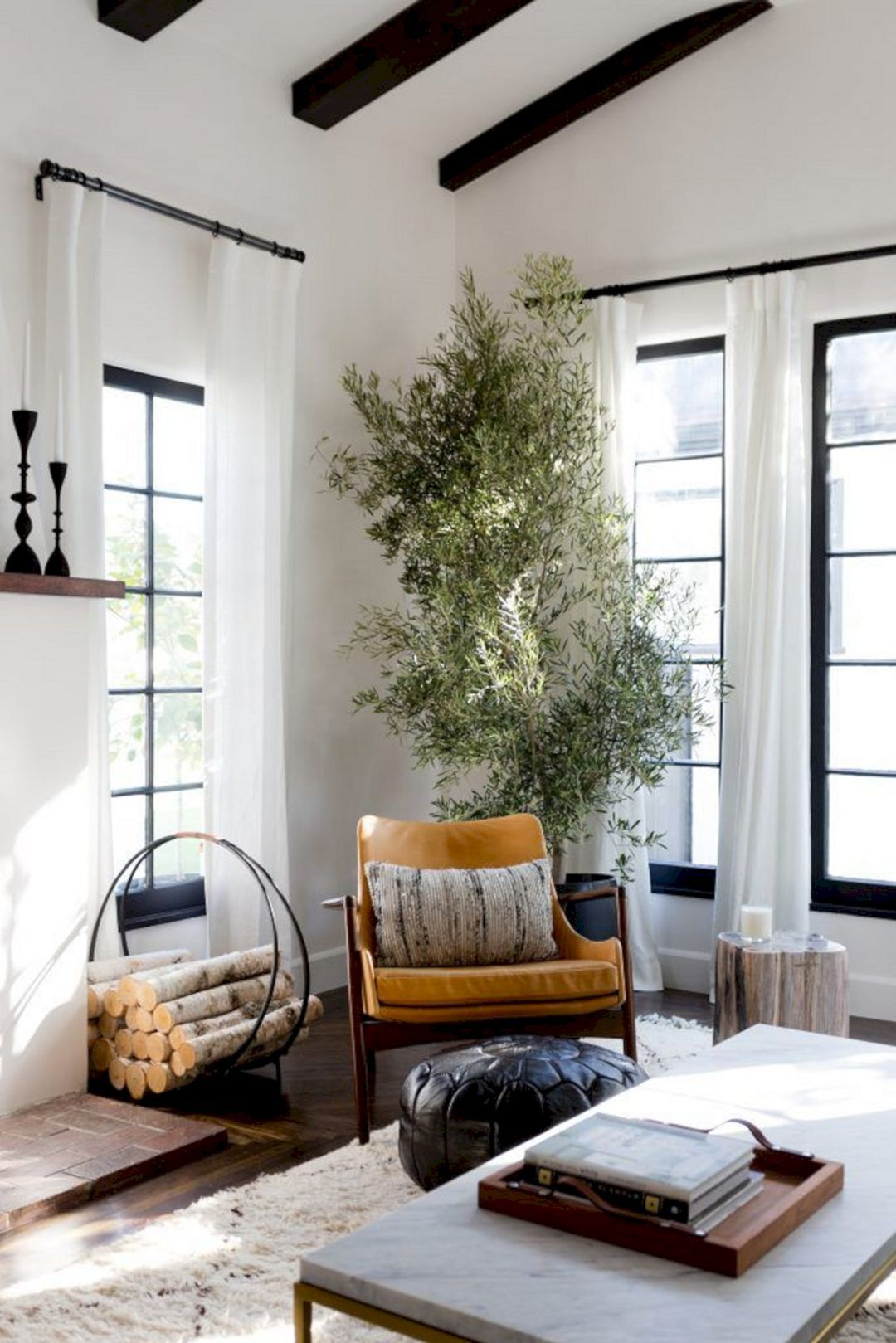 Home decorating ideas living room tree in living room black window frames log holder mid century arm chair cof