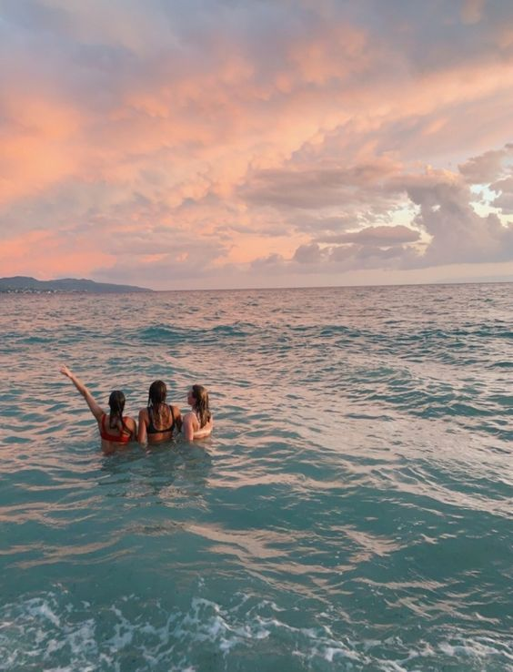 Sunset In The Ocean With Friends