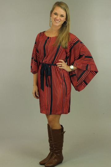 GAMEDAY ALERT!! You will be the envy of the tailgate in this little number:) The Kimono sleeves are right on trend, not the mention the fun striped pattern this dress features. Tie the big bow in the front or on the side... your choice!! This dress is fully lined.  Fits true to size. Lindsay is wearing the small.