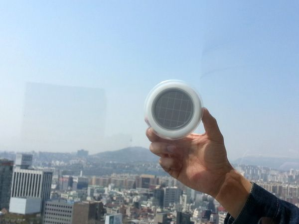 Just stick this portable outlet to your window to start using solar power | Grist...I want one of these!!!