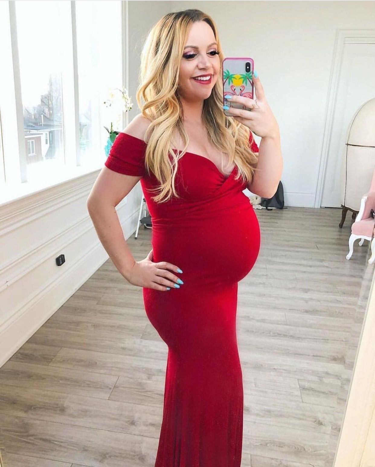 c02bb2c2a42 Pretty mama showing off her  SexyMamaMaternity gown pre maternity photo  shoot! This red matenrity