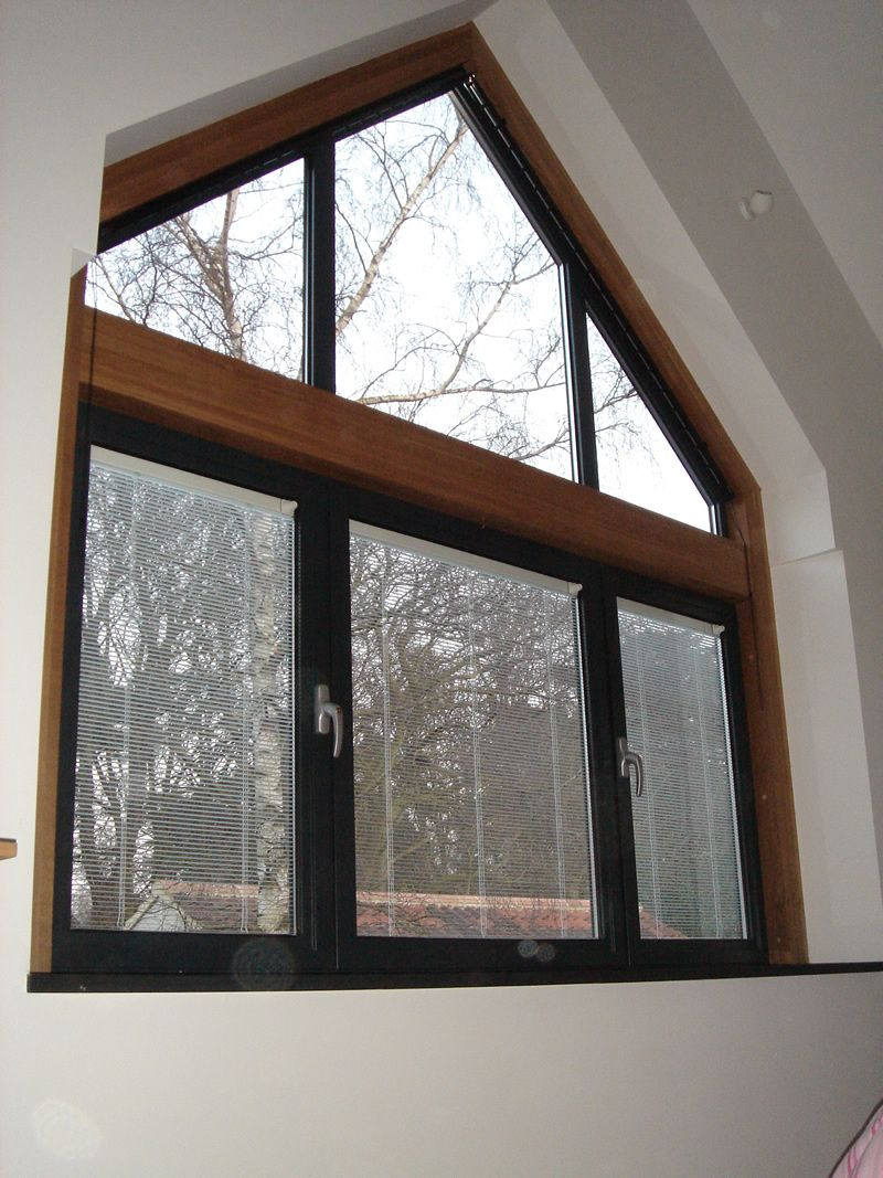 Let Anderson Help You Replace Your Windows With Style Gable Window Attic Flooring Attic Renovation