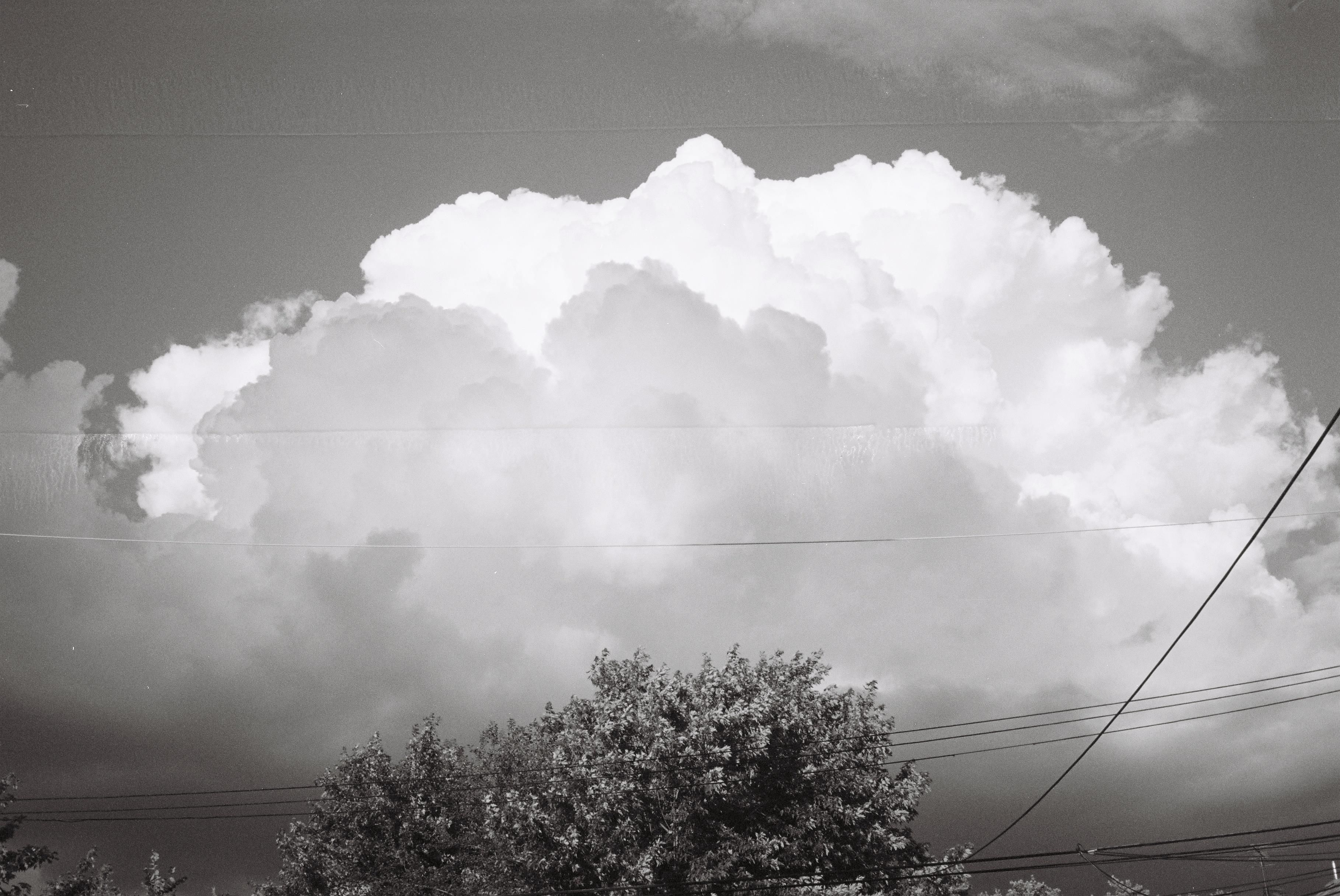 Konica C35 EF  Beautiful Chicago clouds and not so beautiful Chicago power lines.  Taken with a very old camera.