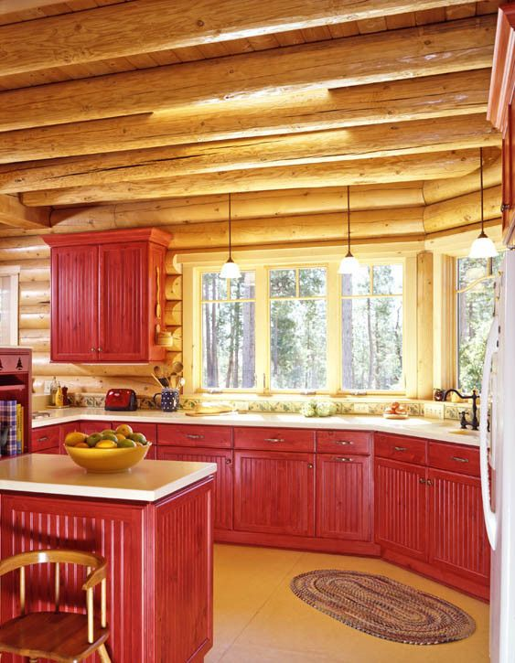Log Home Kitchen With Red Stained Cabinets