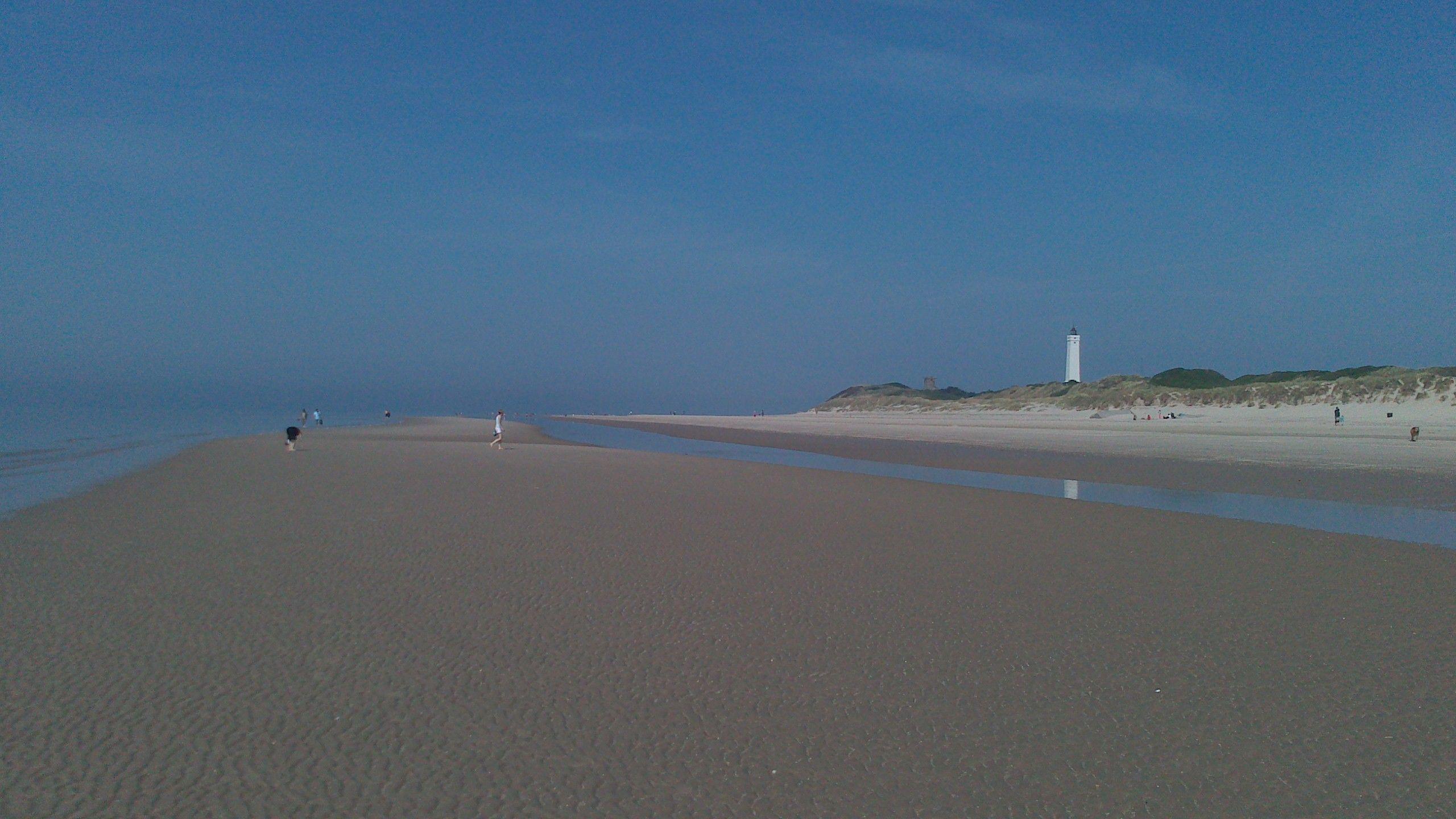 Sandy beach+lighthouse+sun= perfect day