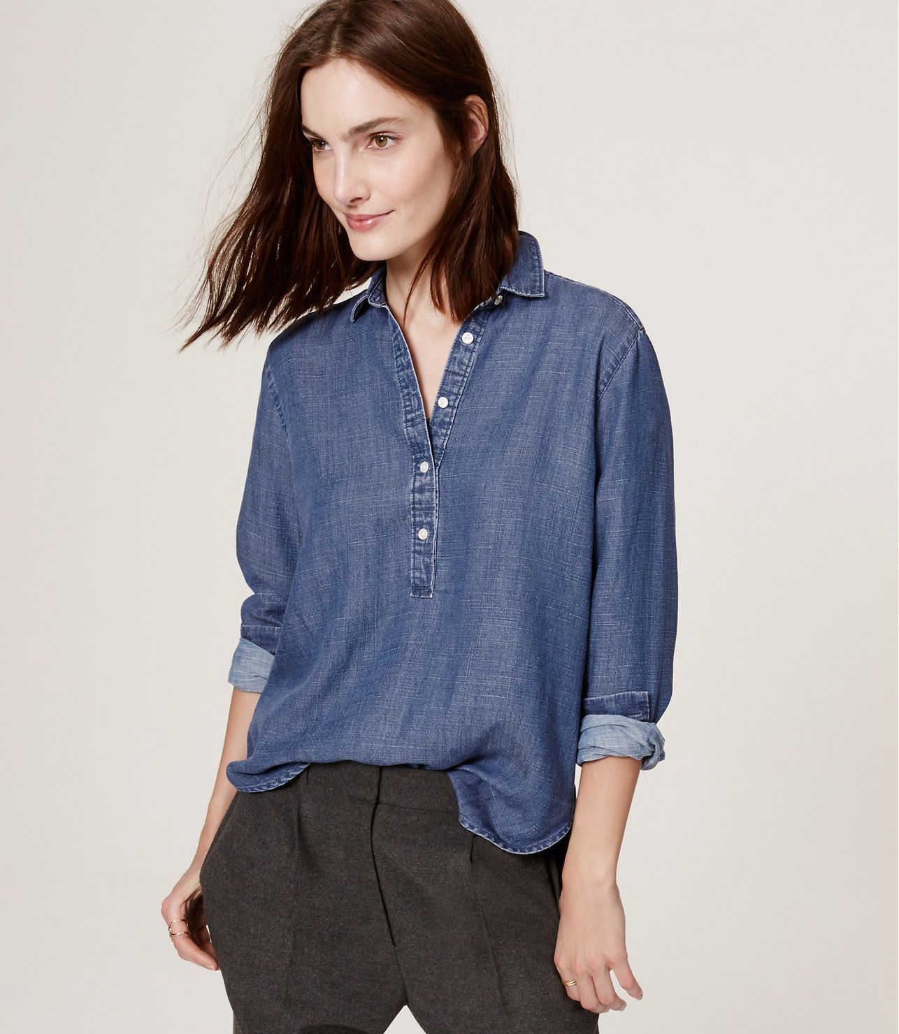 Meet the softened shirt – a light and airy button-down, with no detail left unbuttoned. Pleated in back for modern polish, this chambray piece is a total covetable. Collared. Long sleeves with button cuffs. Henley button placket. Back yoke with pleat beneath. Shirttail hem.