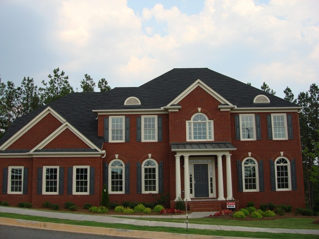 Red Brick House With Black Roof And Black Shutters Home
