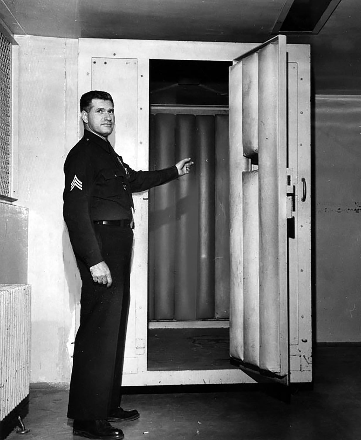 LAPD Sgt. William Menton shows off a padded cell at the