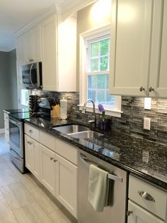Merveilleux My Beautiful Galley Style Kitchen Renovation With Allen Roth Shimmering  Lights Glass Backsplash (from Lowes), White Cabinets, And Butterfly Black  Granite ...