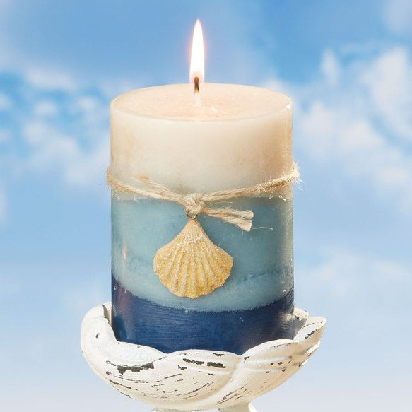 Ocean Mist Scent  3 Wide x 4 Tall       Seaside Decor Boutique    is delighted to offer this Sea Multi 3x4 Pillar . Surf's up Replicating treasured memories of fun times at the beach  has never been so easy. The Sea Multi 3x4 Pillar  makes a great addition to any beach-themed décor , allowing you to enjoy the gorgeous blues of the ocean without getting wet. The tri-toned candle sports an unexpected decorative element, too, in the form of a thin cord that secures a b