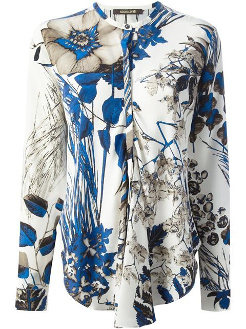 White silk shirt from Roberto Cavalli featuring a round neck, a concealed front fastening, long sleeves, button cuffs, a blue floral print and a curved hem.