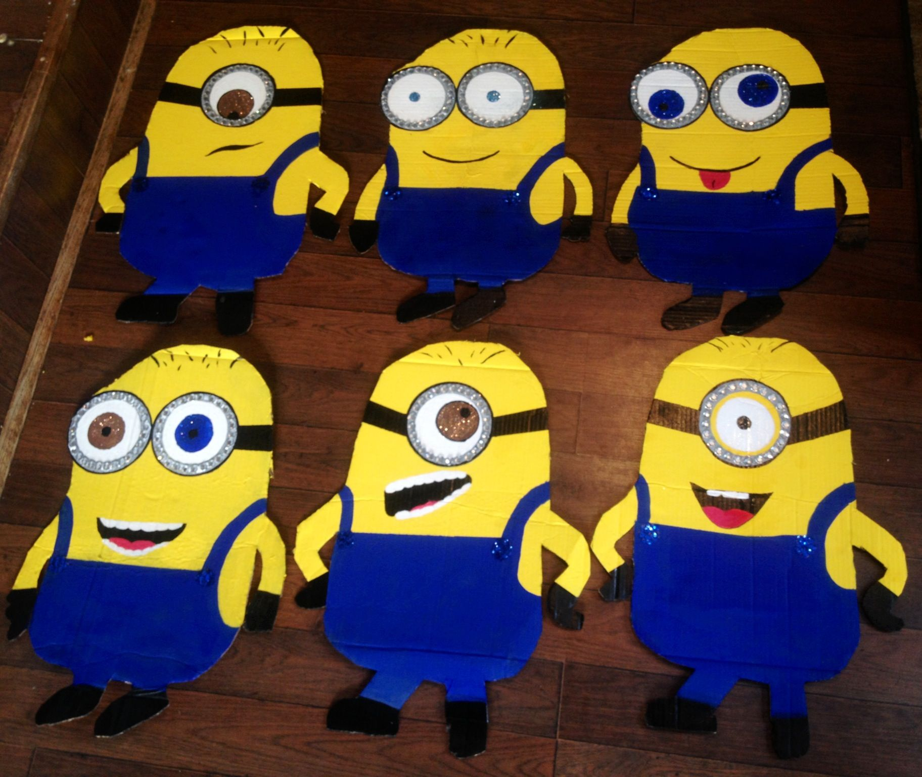 Homemade Minion Decorations From Cardboard Tracing And Cuting Out Using One As A Layout Traced It Cut More Painted Them