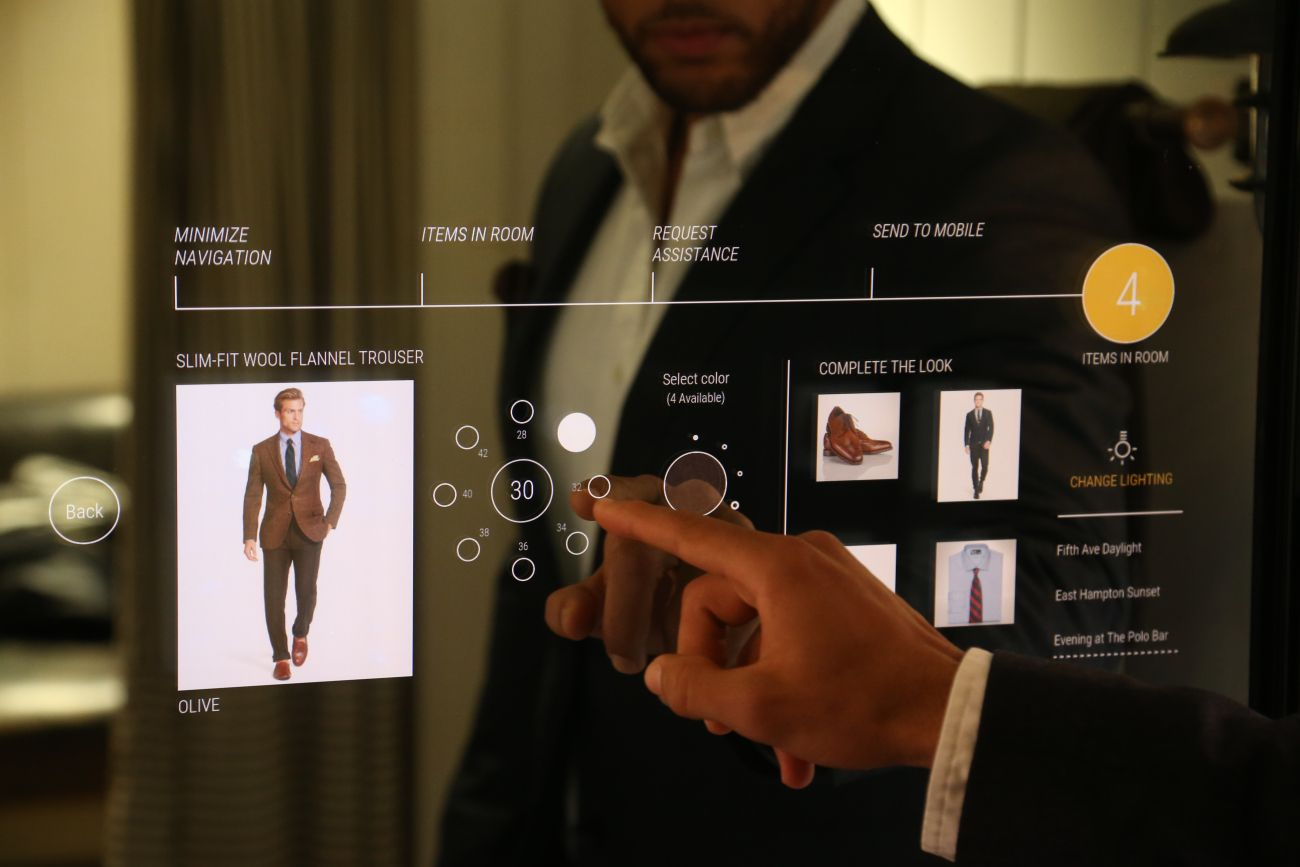 A Polo Ralph Lauren associate trying out the interactive fitting room. ralph-connected-001.jpg