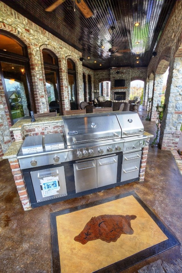 back covered lanai outdoor kitchen bar eating area seating area with a flat screen tv above on outdoor kitchen tv id=31577