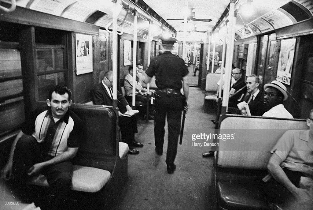 An American policeman on patrol in the New York subway.