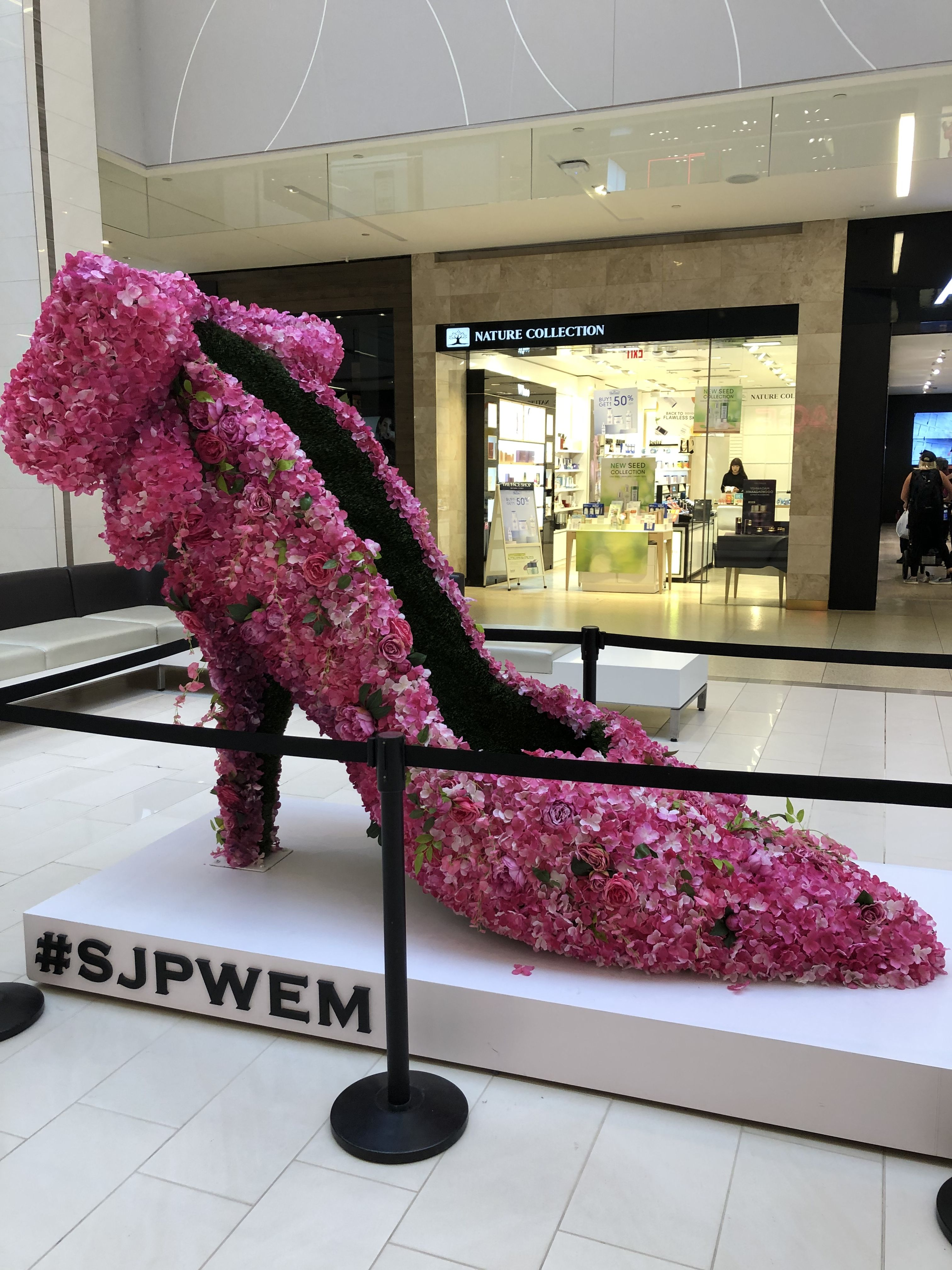 display marking the new SJP shoe store in West