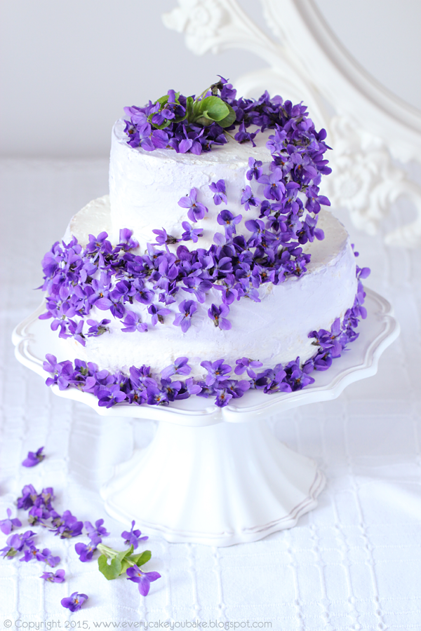 Pretty White Tiered Cake With Cascading Purple Flowers Violet