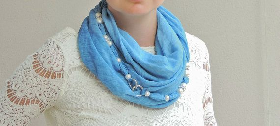Blue jeans-colored jewelry scarf and head scarf in high end fabric, embellished with crystals and smaller accessories. It is an original item