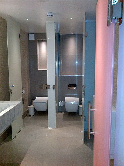 Colourful painted glass washroom entrance door and toilet cubicles ...