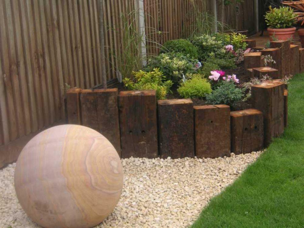 garden bed retaining created with vertical railway sleepers