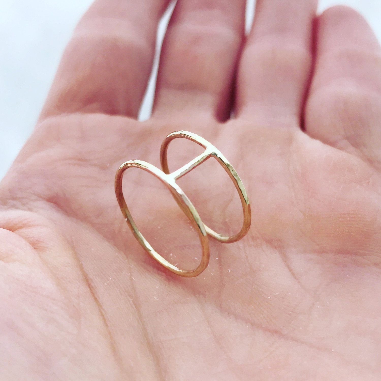 Delicate and lightly hammered double ring with bar. Each ring is ...