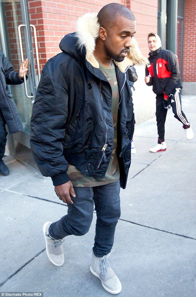 Fancy feet: He sported a casual outfit and wore his newly released Yeezy  Boosts on