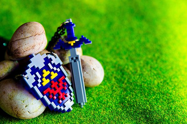 Pixelated Master Sword And Hylian Shield Jewelry Is Just What Link