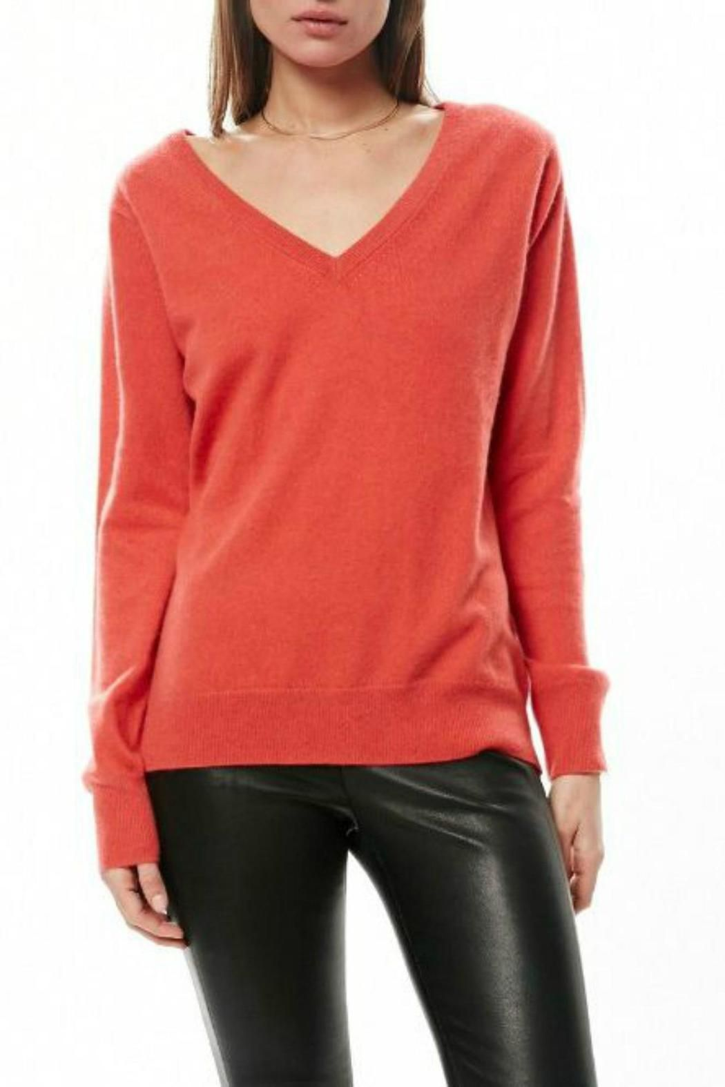 The orange cashmere sweater features a relaxed v in the front and full length zipper in the back. Wear it fully zippered or somewhere in between for a dramatic look. Super soft cashmere and custom VEDA hardware make this sweater one that you definitely need!    Orange Cashmere Sweater by Veda. Clothing - Sweaters - Cashmere Clothing - Sweaters - V-Neck Westchester County, New York