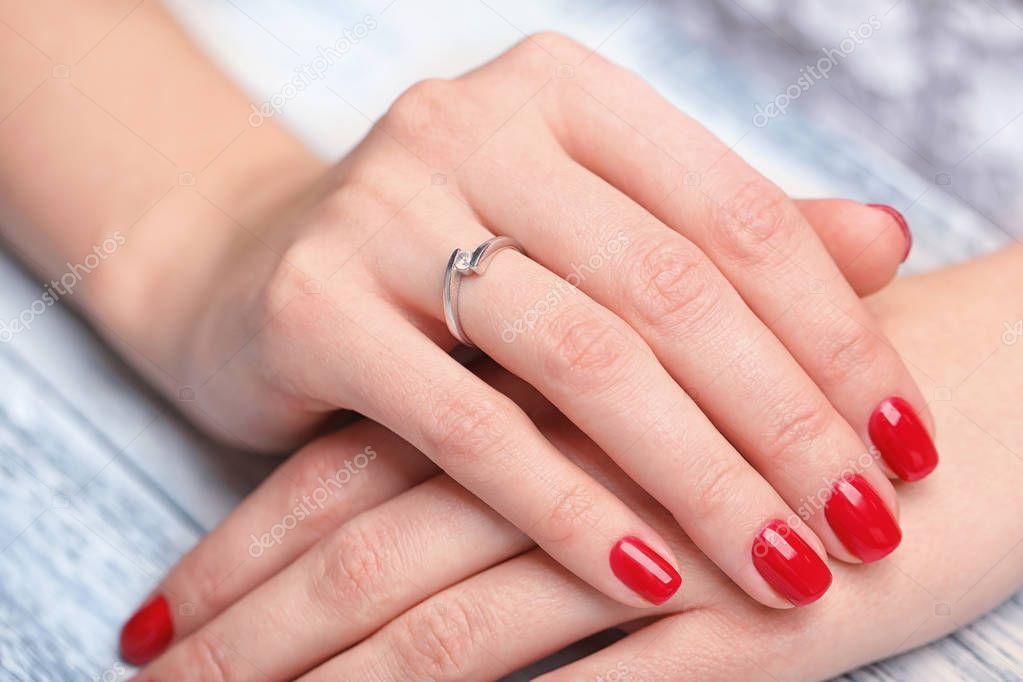 Woman Wearing Beautiful Engagement Ring Closeup - Stock