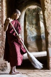 Buddhist monk sweeping.