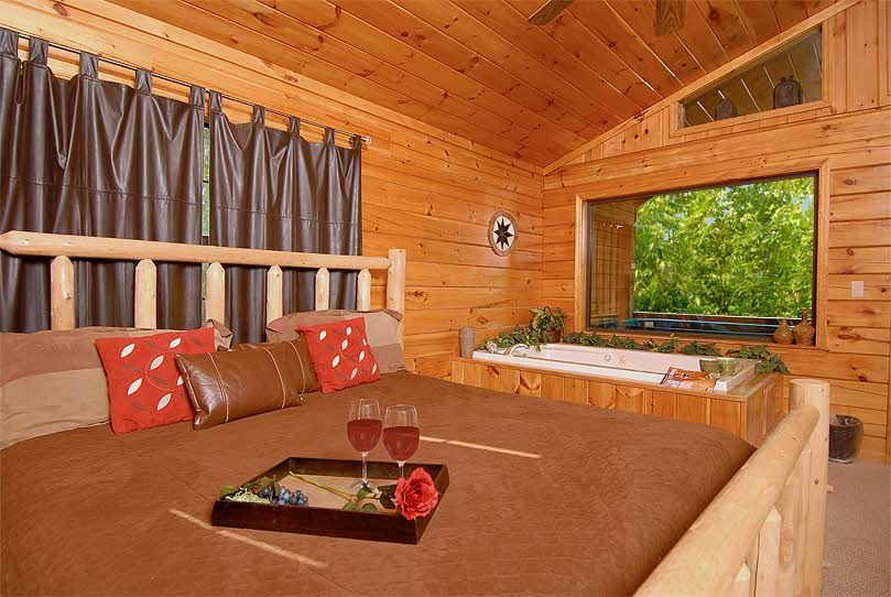 Cowboy Hideaway Is A Beautiful One Story Cabin With A Fabulous Wooded View Located Only Minutes From Dollywood Dolly New Homes Romantic Cabin Honeymoon Cabin