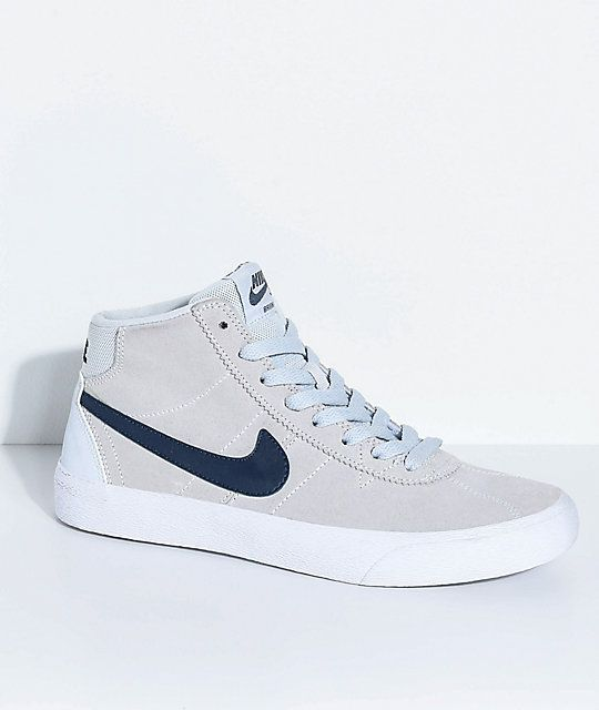 738d4aff2f6d Enhance your sporty looks with Nike SB's iconic Bruin Hi Skate Shoes, now  draped in a pure platinum, obsidian and white colorway. Made with a durable  suede ...