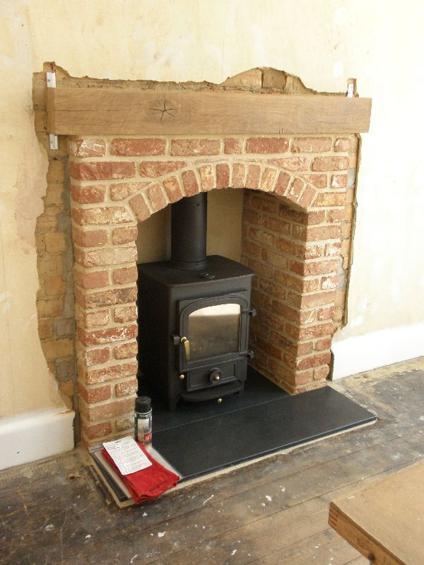 Pioneer 400 woodstove with brick arch fireplace