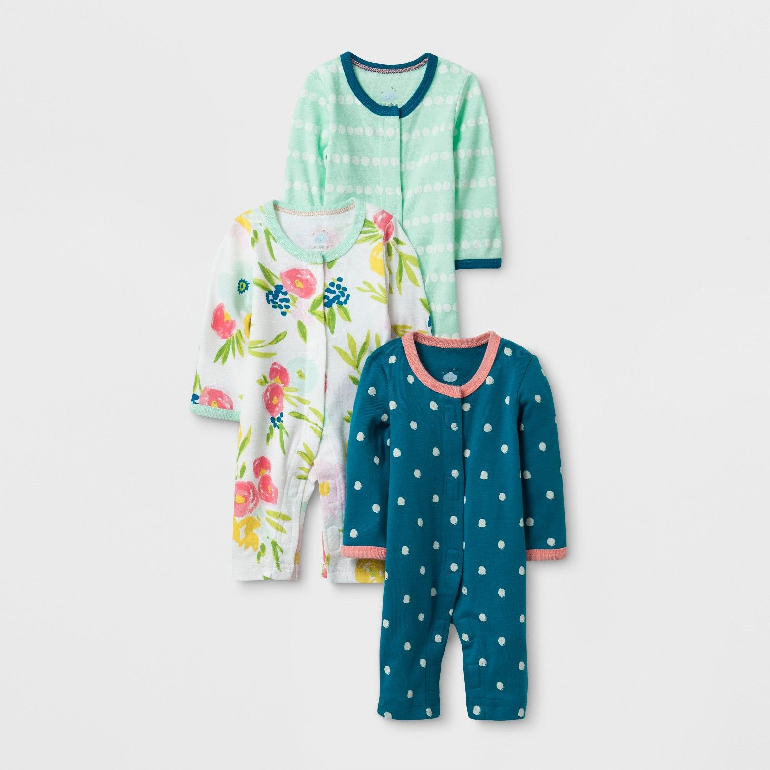 Polka dots and floral print cover the pajamas in this mint and blue