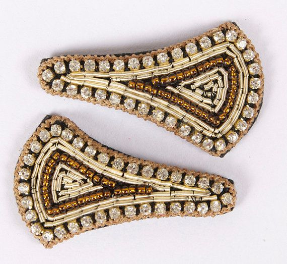 """A beautiful pair of hand embroidered broad triangular, almost kite shaped snap clips-""""tick tock clips"""". Gold thread edging with diamonds and brown beading embroidery in the center. Snap clip, diamantes, hand embroidered.  Gold, Brown, Beading & Diamantes. Rectangle with rounded edges; Approx. 1 1/2 inches length by 1/2 inch width Unique and beautiful on young girls and adults.  £8.00 on Etsy. Please click on the Etsy link to purchase."""
