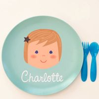 Personalized plate with matching hair, eyes, etc  the site also has water bottles, notepads and tons more