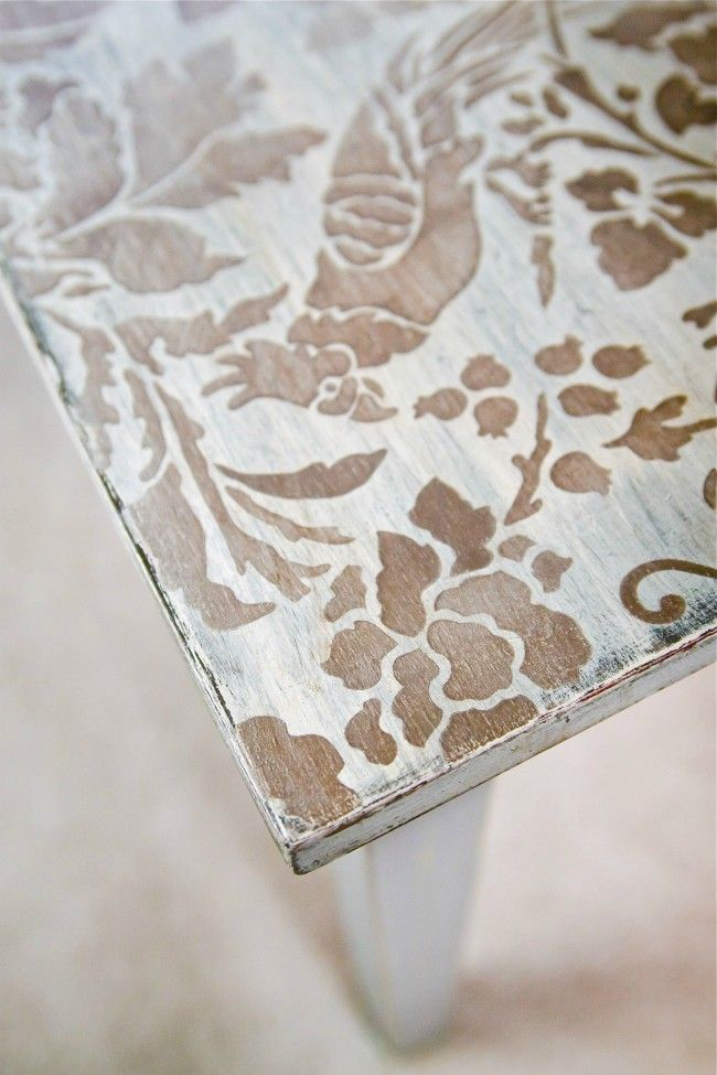 revamp that old coffee table with a cool stencil and a bit of