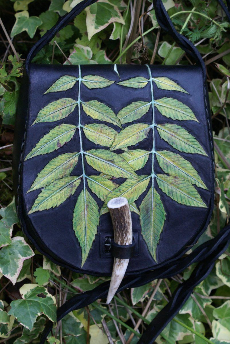 Kennet Bag - triple ash leaf on black leather with mystery braided pierced strap