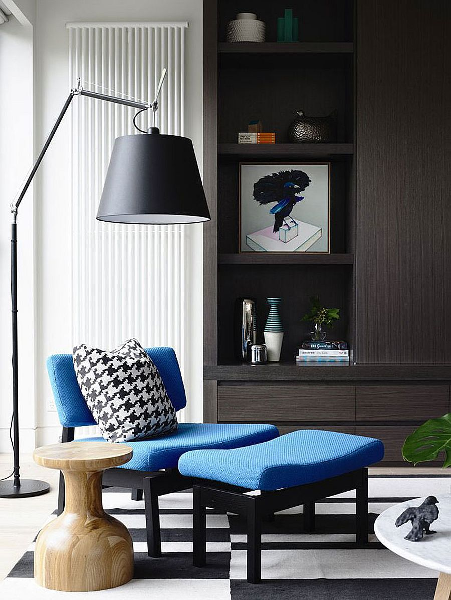 Cozy sitting area with a plush chair and ottoman in blue - Decoist
