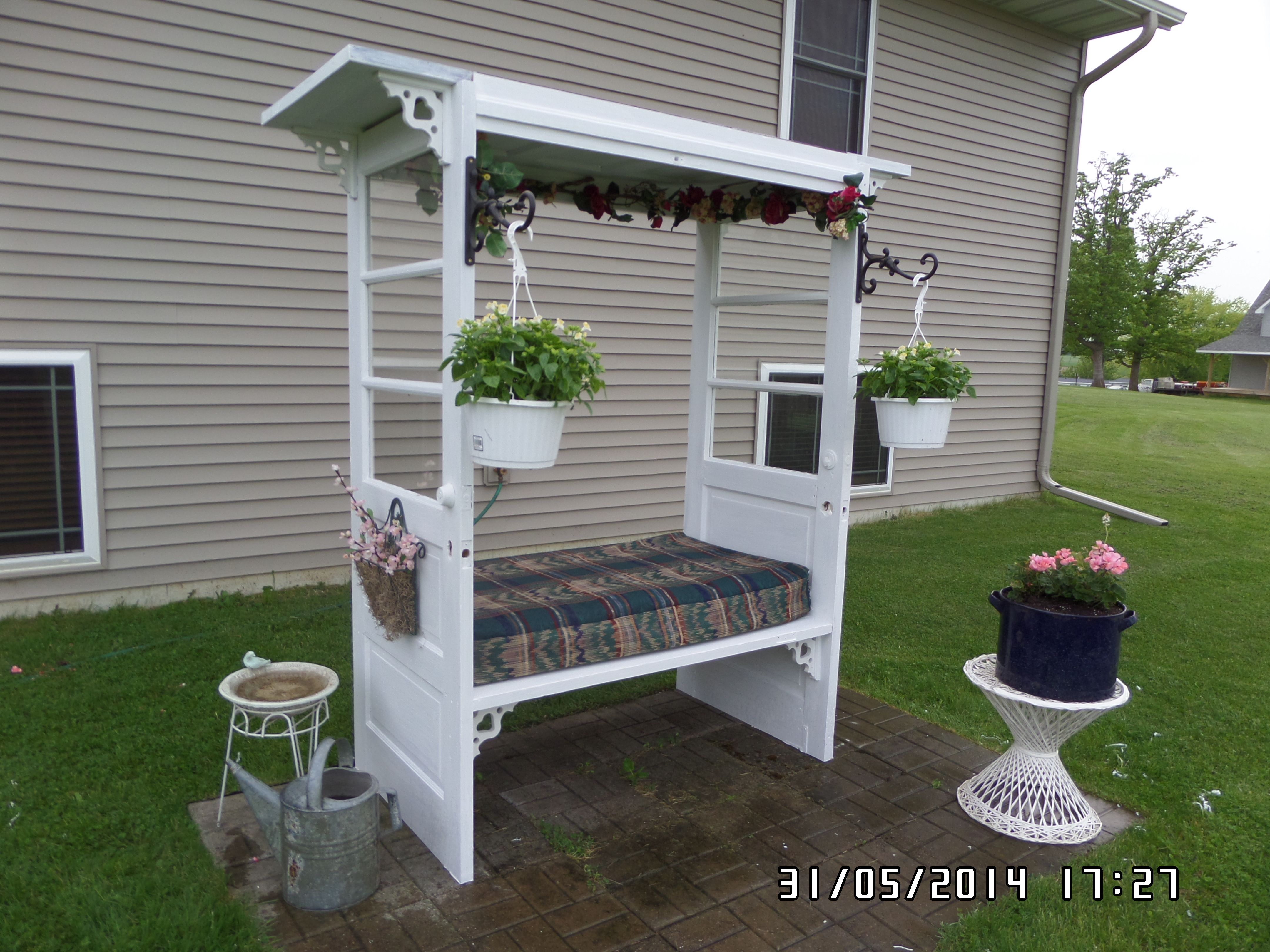 Old doors made into an arbor. We just made one with 4 old