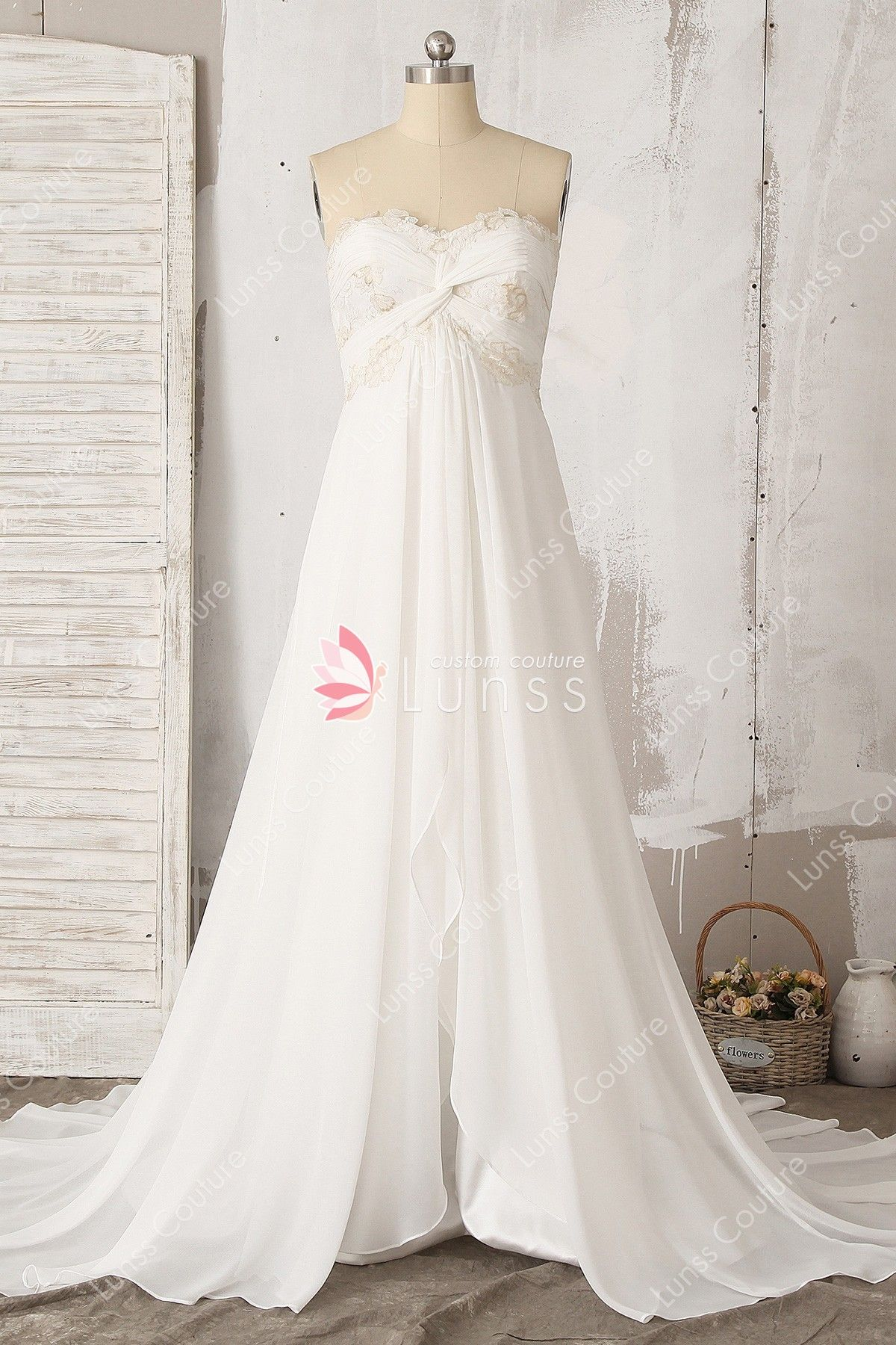 c6daace357720 This long ivory bridal gown features twist bodice with strapless sweetheart  neckline and invisible zipper back