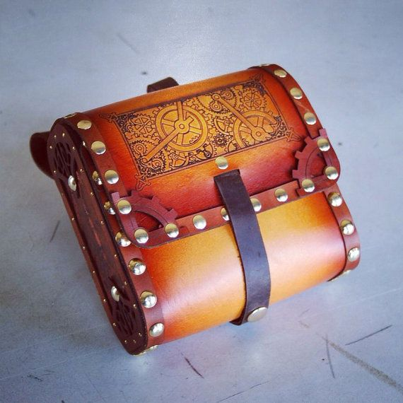 Lovely leather.  https://www.etsy.com/listing/96687172/leather-cog-pouch