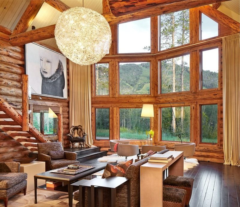 Log walls, dark wood floors, an oversized sparkly light and those ...