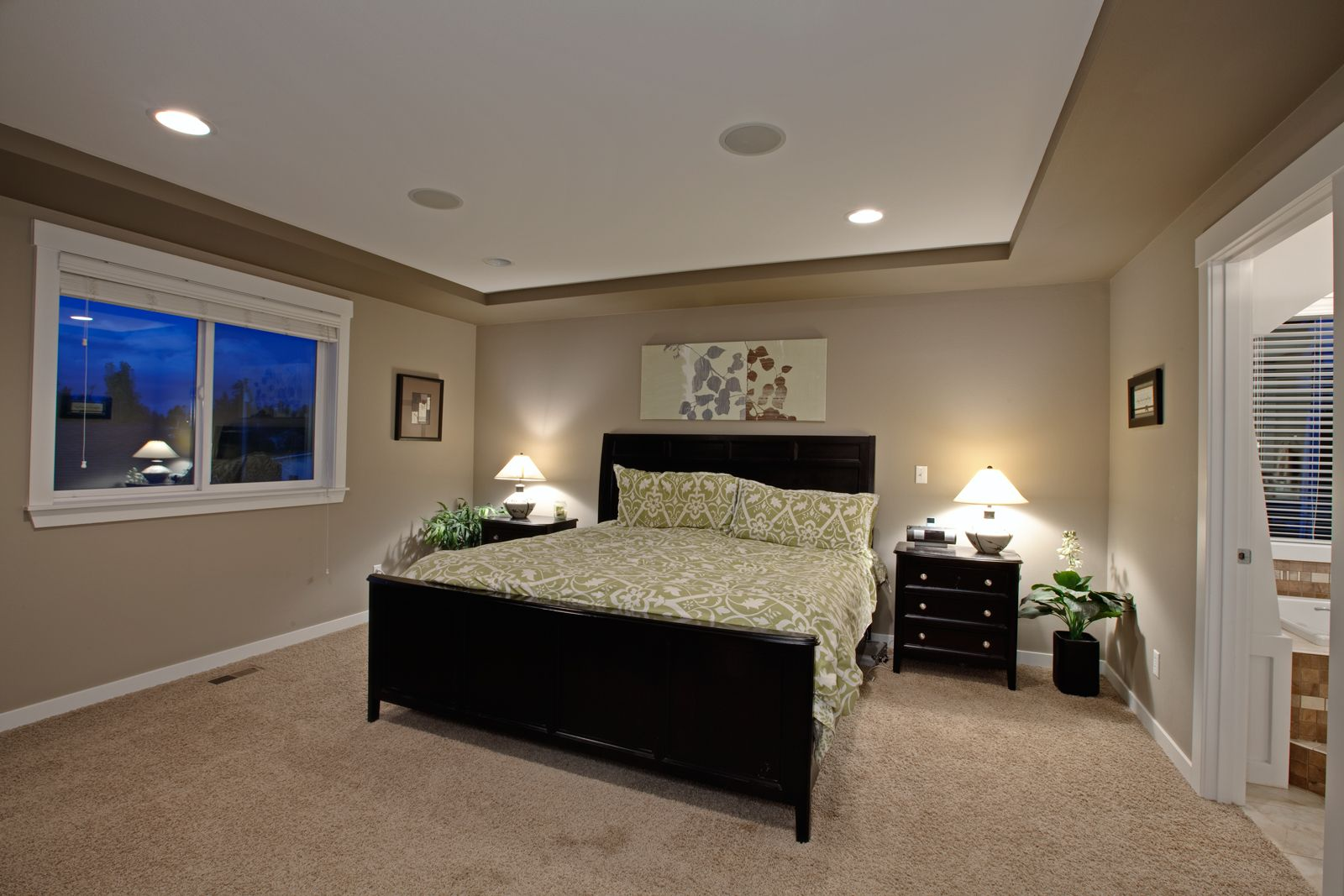 Master bedroom with an two toned drop ceiling, speakers
