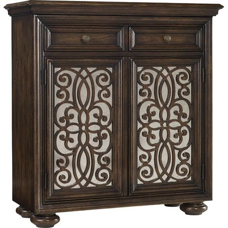 Ornate fretwork laid over shimmering mirrored panels sets this stylish cabinet apart. From the entryway to the library, any space is artfully elevated with t...